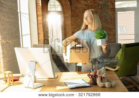A Young Businesswoman Moving In The Office, Getting New Work Place. Young Caucasian Female Office Wo