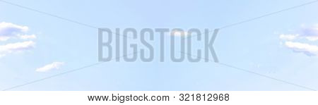 Bright Blue Sky Background With Light Sky Texture On Sunny Day. Soft Azure Colored Banner Of Sky Wit