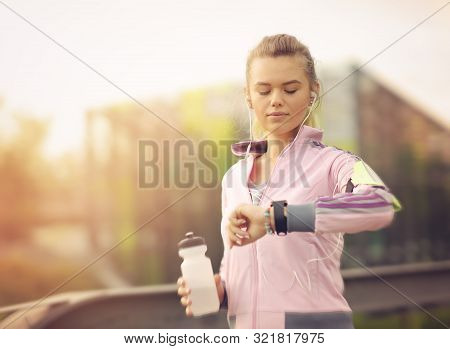 Female Runner Running At Sunset In City Park - Healthy Fitness Woman Jogging Outdoors - Athlete List