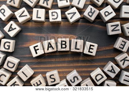 Fable - Word From Wooden Blocks With Letters, Literary Genres Concept, Random Letters Around, Top Vi