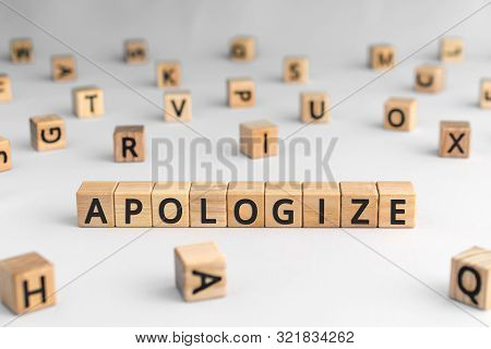 Apologize - Word From Wooden Blocks With Letters, Sorry Concept, Random Letters Around, White  Backg