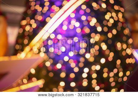 Abstract background of bokeh Christmas tree, Christmas tree light decoration, string lighting on christmas tree, blur Christmas tree, garland lights, fir tree lighting, Xmas decoration lights