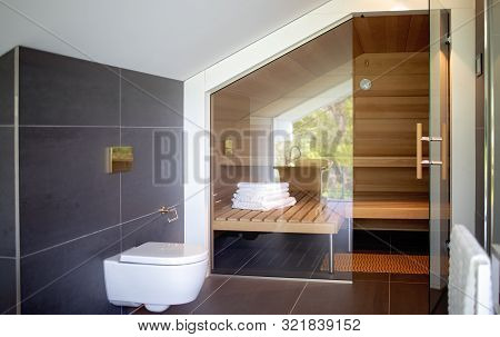 Bucharest / Romania - 21 April 2019: Modern Bathroom And Sauna. Contemporary Interior Of Luxury Hous