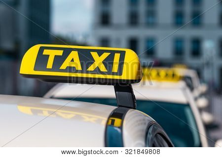 Selected focus at Taxi sign close-up on Taxi service cars