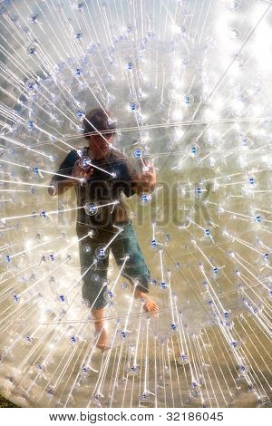 Cute Child Has A Lot Of Fun In The Zorbing Ball