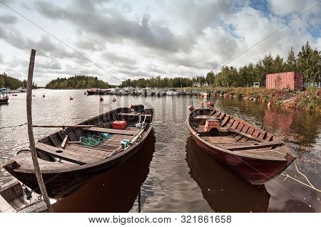 Two Old Wooden Fishing Boats Wait For The Fishermen At The Harbour Of Kalajoki, Finland. These Tradi