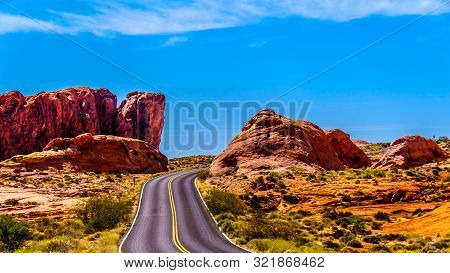 The White Dome Road Winding Through The Red Sandstone Rock Formations In The Valley Of Fire State Pa