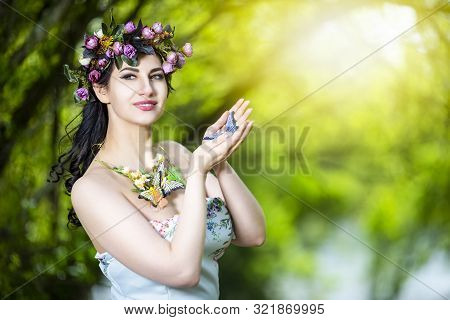 Fantastic Portrait of Sensual Brunette Female in White Dress Outdoors. Posing with Flowery Chaplet and Butterfly Against Sunlight. Horizontal image Composition poster