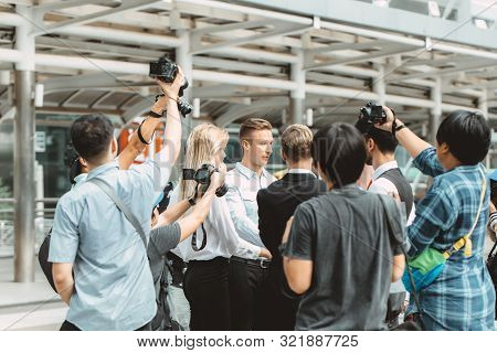 Business Man Important Press Release Surrounded Scramble With Reporters Newspaper Journalist Photogr
