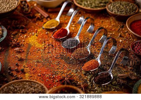 Collection Of Spices In Spoon. Spice And Herb Concept