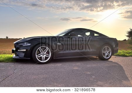 Schleswig-holstein, Germany - September 13, 2019: Ford Mustang 2018 Black Sports Car Sunny Day View
