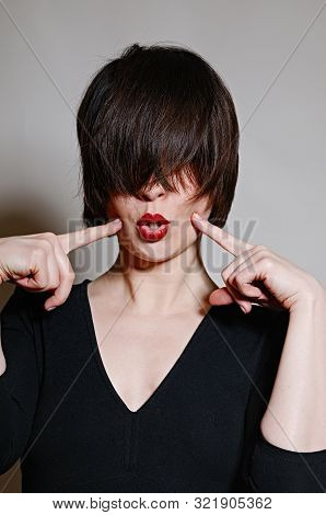Emotional Woman Portrait With Red Lips And Dark Short Hair