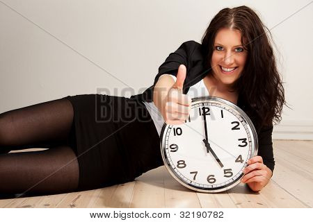 Confident Young Professional With A Clock