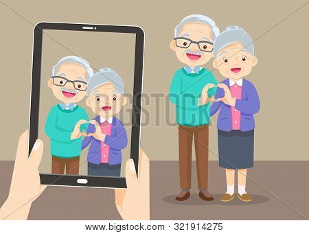 Tablet Pc With The Family Photo,hands Holding Touch Screen Tablet Pc With Photo.group Of People Stan