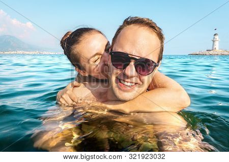 Couple Taking Selfie In Water While Swimming In The Sea On Holiday. Two Happy People On Fun Family V