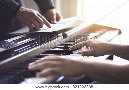 Piano Teacher And Student Practising. Music Lesson And Course In School. Man Learn Playing With Tuto