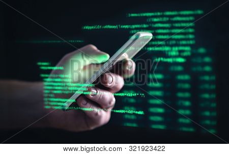 Darkweb, Darknet And Hacking Concept. Hacker With Cellphone. Man Using Dark Web With Smartphone. Mob