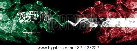 Saudi Arabia Kingdom Vs Latvia, Latvian Smoky Mystic Flags Placed Side By Side. Thick Colored Silky