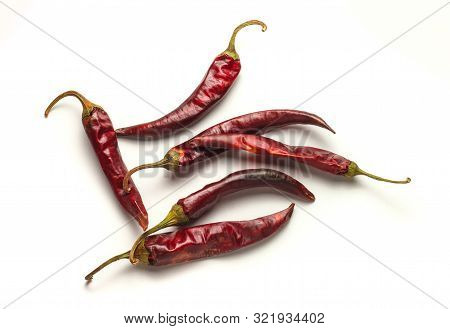 Dried Chilly Papper On White Background. Red Pods