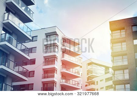 Modern Apartment Buildings On A Sunny Day With A Blue Sky. Facade Of A Modern Apartment Building.gla