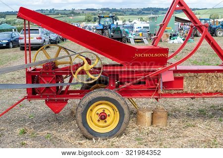Haselbury Plucknett.somerset.united Kingdom.august 18th 2019.an Old Fashioned Square Baler Is Making
