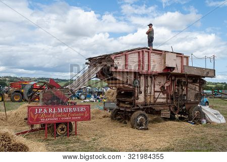 Haselbury Plucknett.somerset.united Kingdom.august 18th 2019.a Vintage Threshing Machine Is On Displ