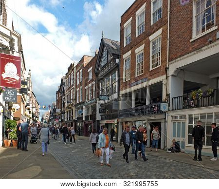 Chester, Cheshire, United Kingdom - 7 September 2019: People Walking Along Watergate Street Past Pub