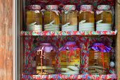 Habu snakes in jars are sold from the colourful shelves of a shop in Naha Okinawa Japan. poster