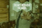 Conceptual hand writing showing Do Not Reinvent The Wheel. Business photo text stop duplicating a basic method previously done Woman wear work suit presenting presentation smart device. poster