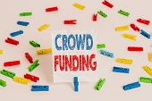 Text sign showing Crowd Funding. Conceptual photo Fundraising Kickstarter Startup Pledge Platform Donations Colored clothespin papers empty reminder white floor background office. poster