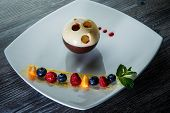 exceptional chocolate ball dessert with assorted berries poster