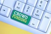Handwriting text Crowd Funding. Concept meaning Fundraising Kickstarter Startup Pledge Platform Donations White pc keyboard with empty note paper above white background key copy space. poster