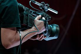 The Operator Shoots Video At A Sporting Event. Professional Video Technician At Work. Videographer F