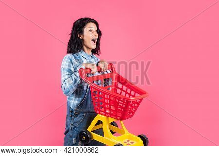 Pleasant Shopping. Happy Girl Hold Shopping Cart. Buyer In Supermarket. Customer With Empty Cart. Fe