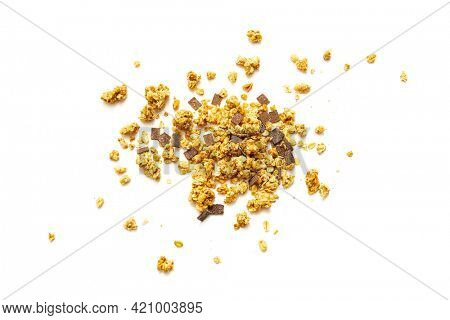 Pile of crunchy muesli with chocolate on white background