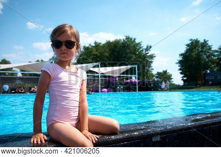 Happy Little Girl By The Pool. Summer Vacation.