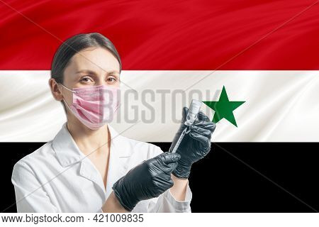 Girl Doctor Prepares Vaccination Against The Background Of The Syria Flag. Vaccination Concept Syria