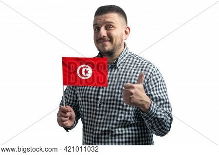 White Guy Holding A Flag Of Tunisia And Shows The Class By Hand Isolated On A White Background. Like