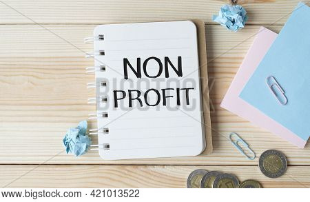 Text Non Profit On Stickers. Clipboard With Charts, Pen, Piggy Bank And Calculator On Blue Backgroun