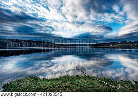 Blue Hour Sunrise Over The Lake With A Beautiful Reflections On The Water. Serene Lake In Blue Hour.