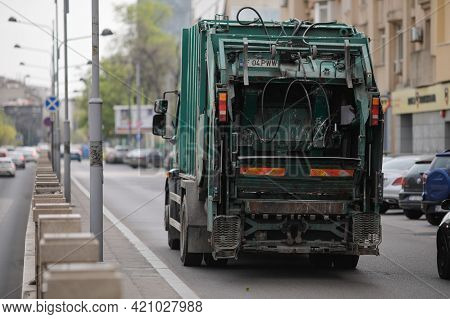 Bucharest, Romania - April 27, 2021: Garbage Truck On The Streets Of Bucharest.