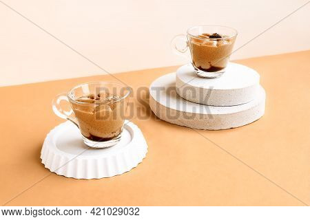 Traditional Italian Dessert Coffee Cream In A Glass Cups On Beige Background. National Cuisine Recip