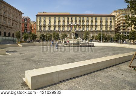Naples, Italy - September 4, 2016: View Of The Neptune Fountain And The City Hall At Municipio Squar