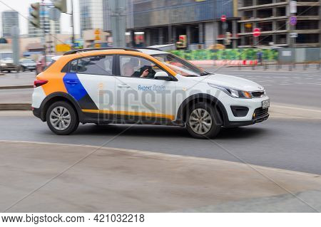 Yandex Drive Carsharing Car Rushes Along City Street With Motion Blur Effect. Cheap Car For Sharing
