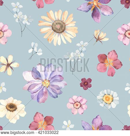 Floral watercolor seamless pattern with colorful flowers in herbarium style. Hand painting image, print in pastel colors on blue background.