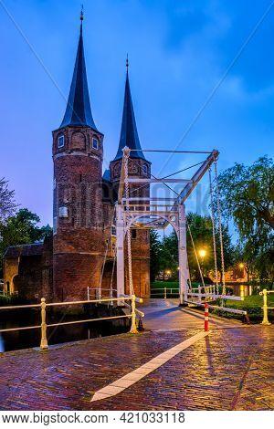 Oostport (Eastern Gate) of Delft with drawbridge in night. Delft, Netherlands