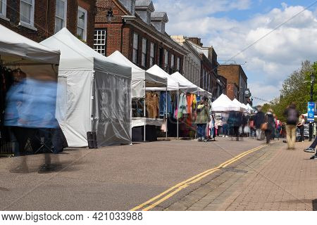 St Albans-uk - 19 May 2021 - People Shopping And Walking On Busy Retail High Street With Market Stal