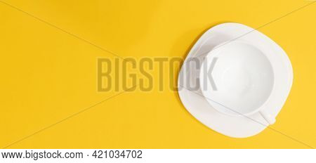 Top View Of White Coffee Cup On Saucer On Yellow Background, Panoramic Shot With Copy Space