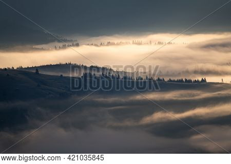 Beautiful Sunrise Over Hills And Countryside. Misty Morning Landscape With Dramatic Sky