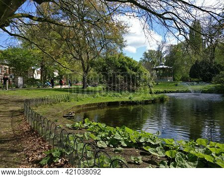 In Brugges Walking Through Park Area On A Beautiful Day